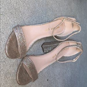 Gold sparkly pair of Madden girl heels.
